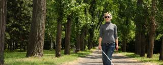 blind woman walking