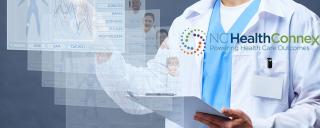 male doctor viewing patient information virtually