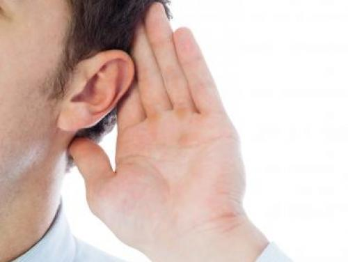 Person with hand to their ear