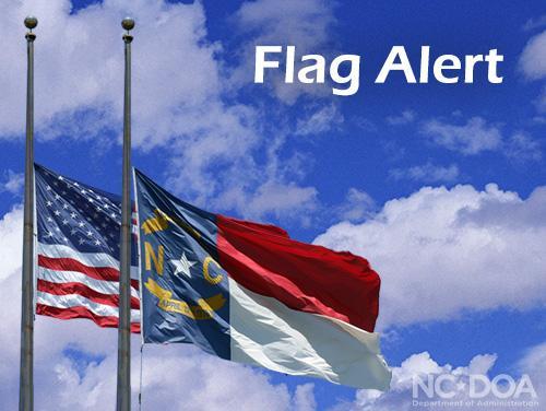 US and NC flag flying at half mast