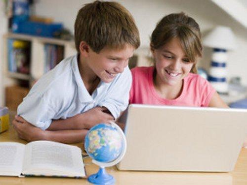 Young girl and boy studying with books and laptop