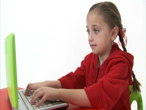 Young girl using a lime green laptop