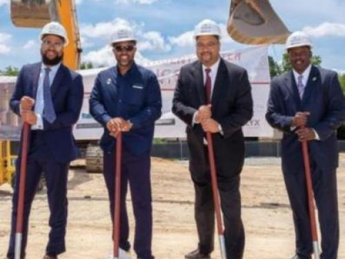 Four Men with Shovels Breaking Ground