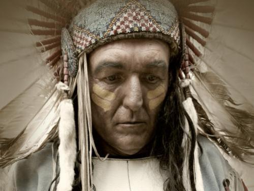 American Indian with feathered head dress