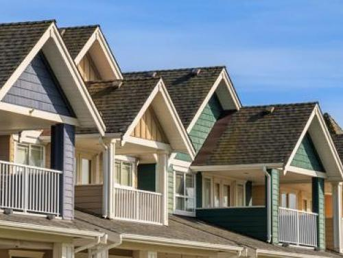 Row of townhouse roofs