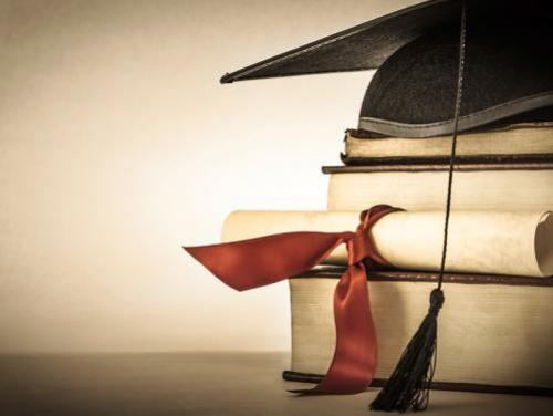 Diploma on a stack of books