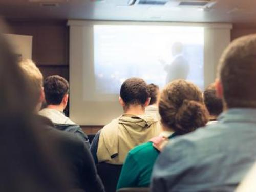 Training audience looking at a projector