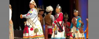 American Indian Heritage Celebration with men and women dressed in colorful Indian clothing and head dresses,