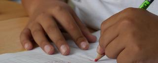 Child drawing on graph paper