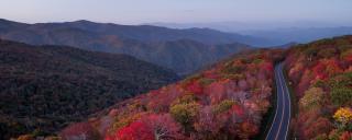 Bird's-eye View of Road Through Mountains with Fall Foliage