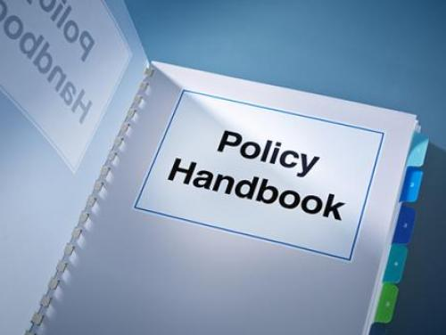 policy handbook with tabs