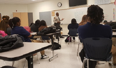 A State Highway Patrol trooper speaks to Bertie County High School students as part of the Public Safety Cadet program.