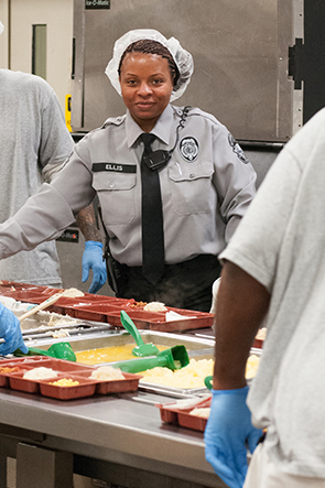 uniformed food service worker in correctional facility