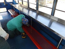 Image of Brown Creek CI inmate working to retrofit bus for 'Meals on the Bus' program