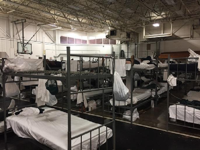 Beds set up in prison gymnasium