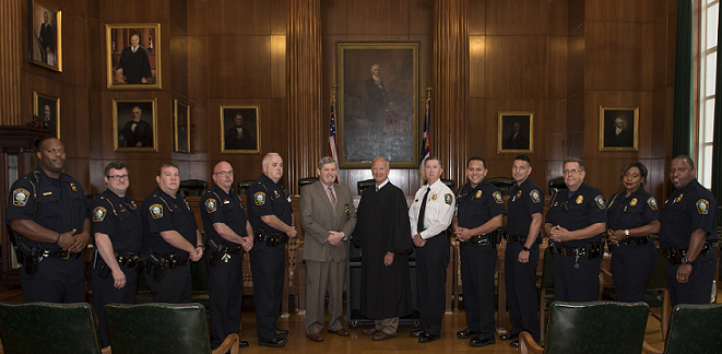 Group of State Capitol Police and judge at swearing ceremony