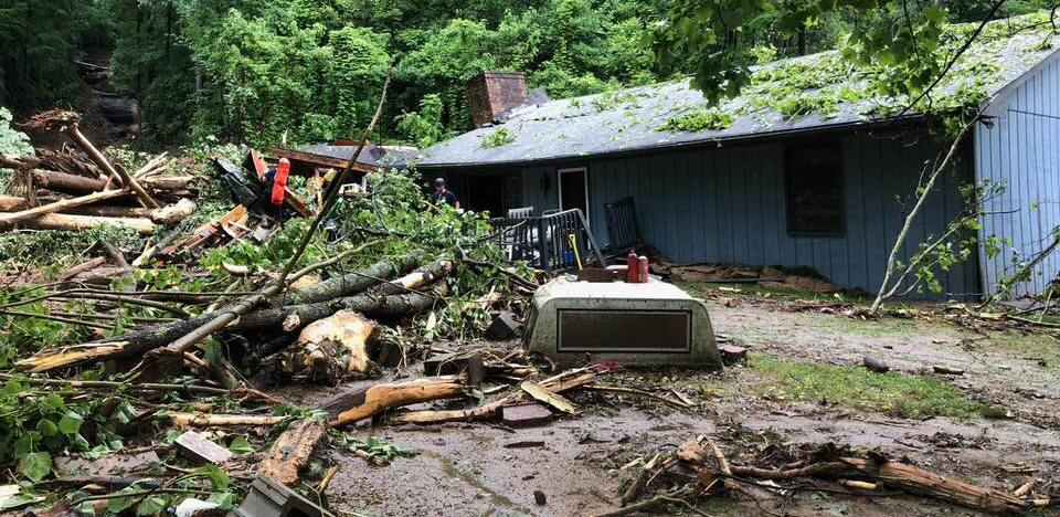 Home damaged by mudslide