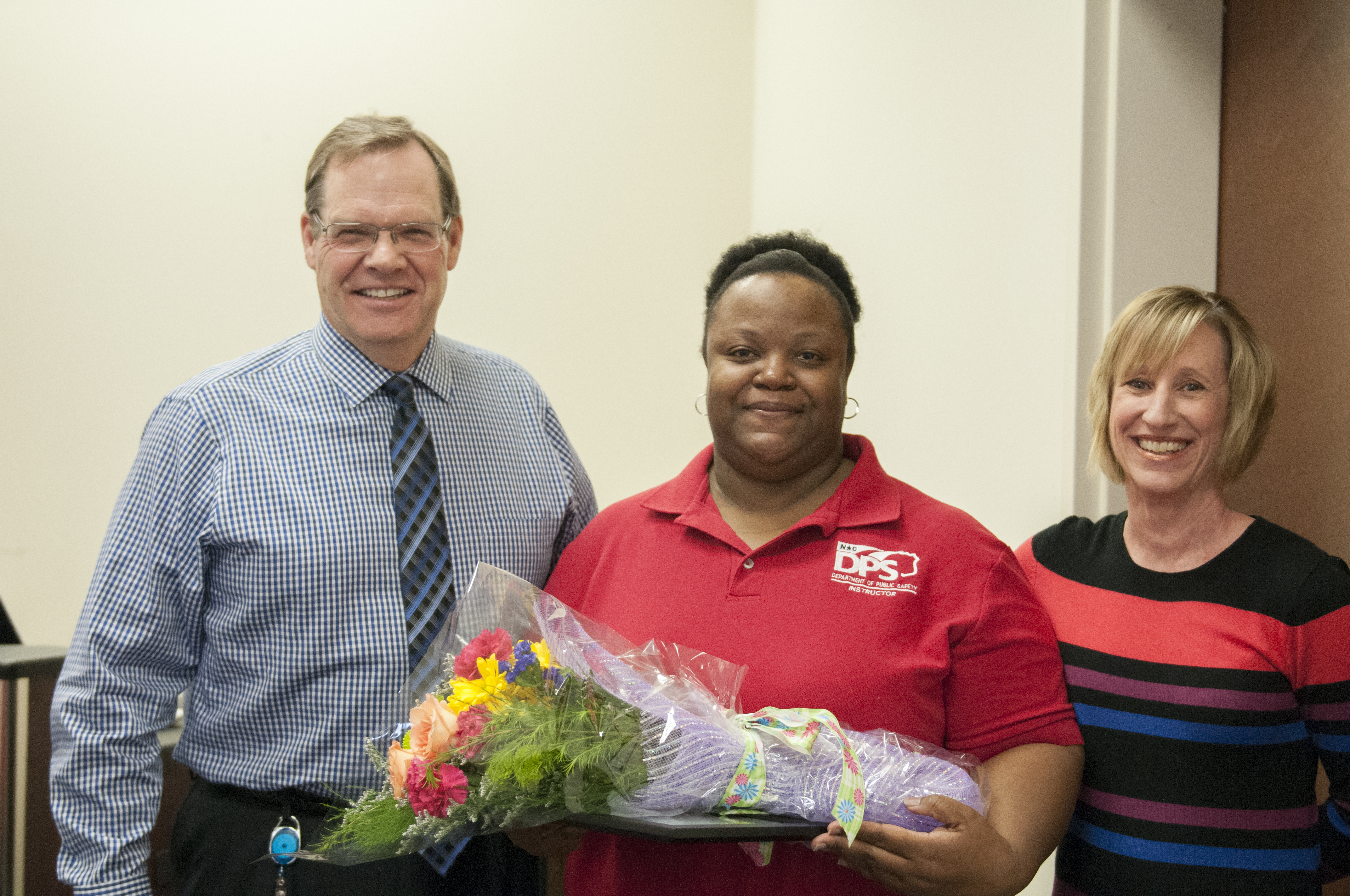 LaTonya Middleton and coworkers presenting flowers