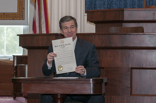 Gov. Cooper signs Raise the Age proclamation