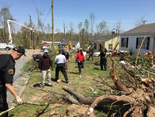 Volunteers clear tornado damage
