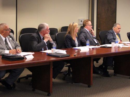 Members of the Prison Reform Advisory Board listen during a presentation.