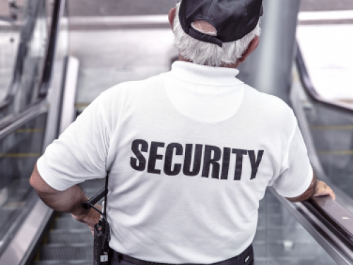 "Security guard with white shirt with ""SECURITY"" written on it in black letters"
