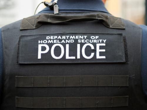 Back of a Dept. of Homeland Security officer