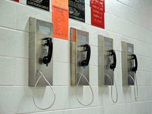 Four wall-mounted telephones
