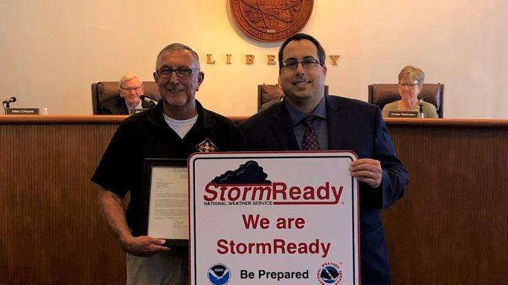 Nick Petro with the National Weather Service presents Robbie Smith with Montgomery County Emergency Management a StormReady plaque.