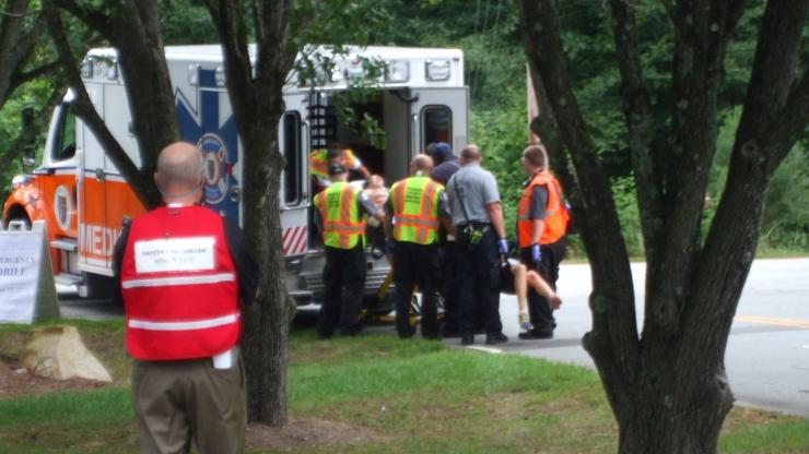 Emergency responders loading drill participant into ambulance