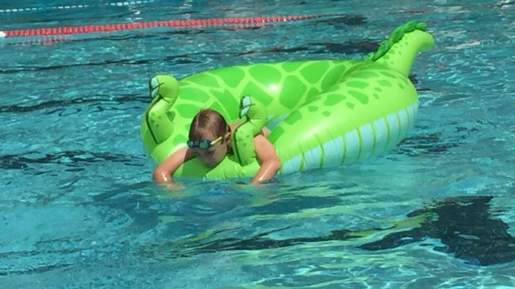 boy in pool on dragon float