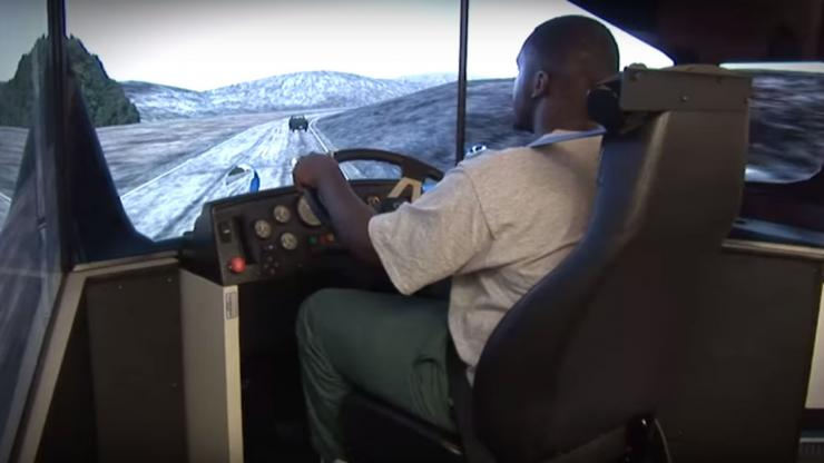 Inmate behind the wheel of truck driving simulator