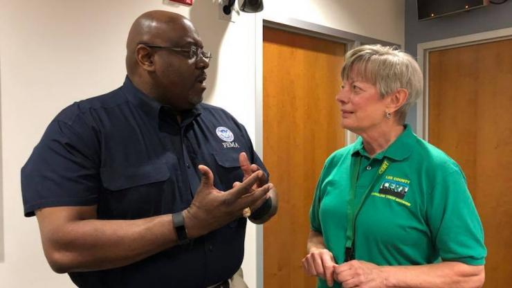 CERT Representative speaks with FEMA Coordinator at the NC Joint Forces HQ during hurricane Florence