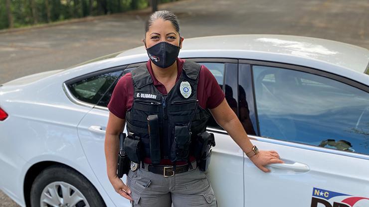 PPO Cindy Ulibarri standing beside DPS car