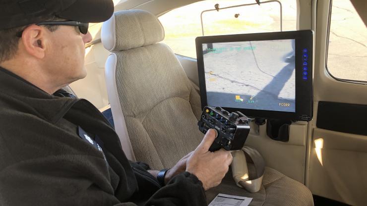 Lt. Col Tedesco operates FLIR camera in Civil Air Patrol aircraft