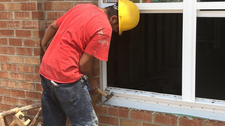 Construction worker fixing window