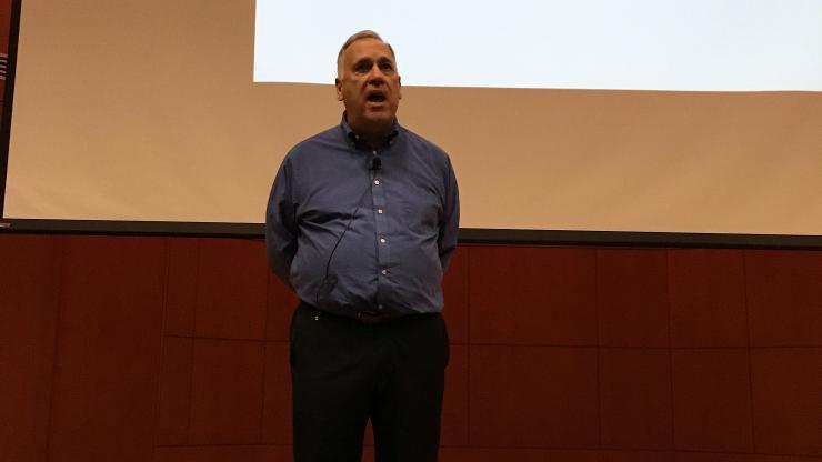 Mohr speaking on stage
