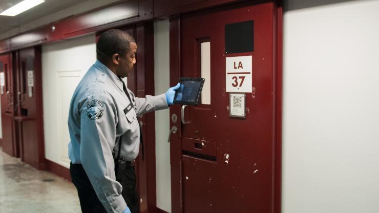 Officer at cell door