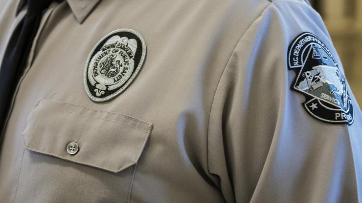 shoulder of corrections officer in uniform