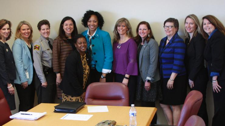 Several women standing in conference room