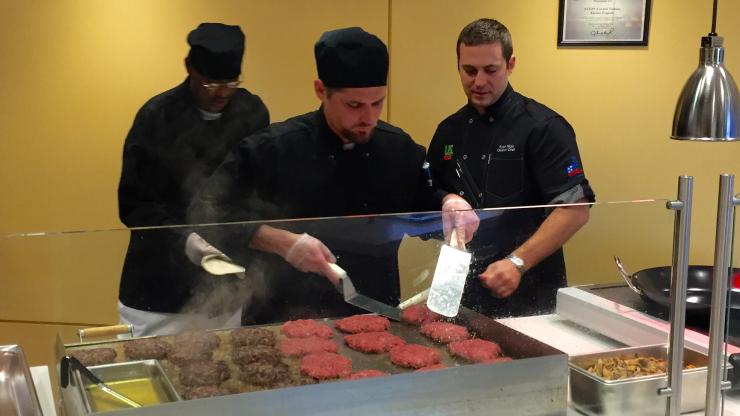 Ryan HIcks with U.S. Foods instructs inmates on flat grill