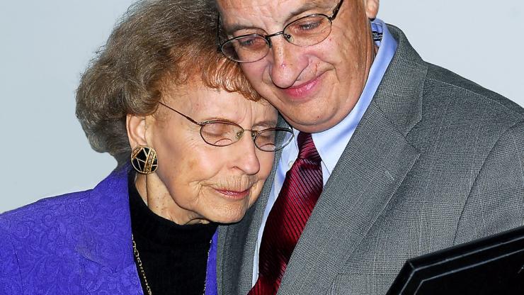 Millie tearfully hugs from Western Region Director, Steve Bailey while accepting award.