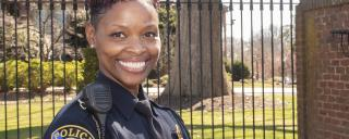 female officer in uniform smiling at camera