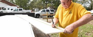 Volunteer works on STEP home