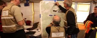 Emergency managers work in command post