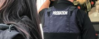 male probation officer and female knocking on door