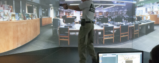 man with gun drawn in training simulator