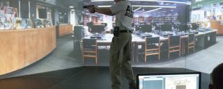 man with gun drawn in training simulator