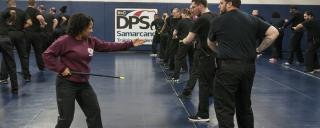 Group of men and women in self defense class