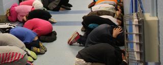 Children kneeling in a hallway